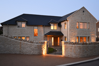 Image of the front of the new build Cotswold country house, designed by Hetreed Ross Architects.