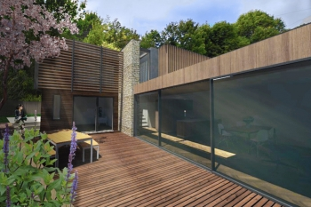 Image illustrating external L-shaped courtyard with large glazed sliding doors