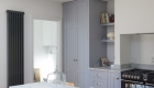 Image illustrating new kitchen space, large cupboards and plenty of storage arranged in a minimal way.