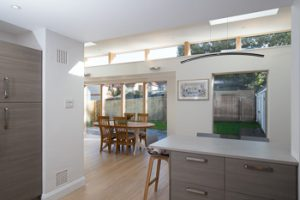 View from the kitchen into the bright airy dining area and out into the garden.