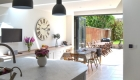 View from the kitchen showing the light and airy family kitchen/dining room. Illustrates how the lowered floor, roof lights and large bi-fold doors transforms the interior which now flows into the garden via a paved terrace.