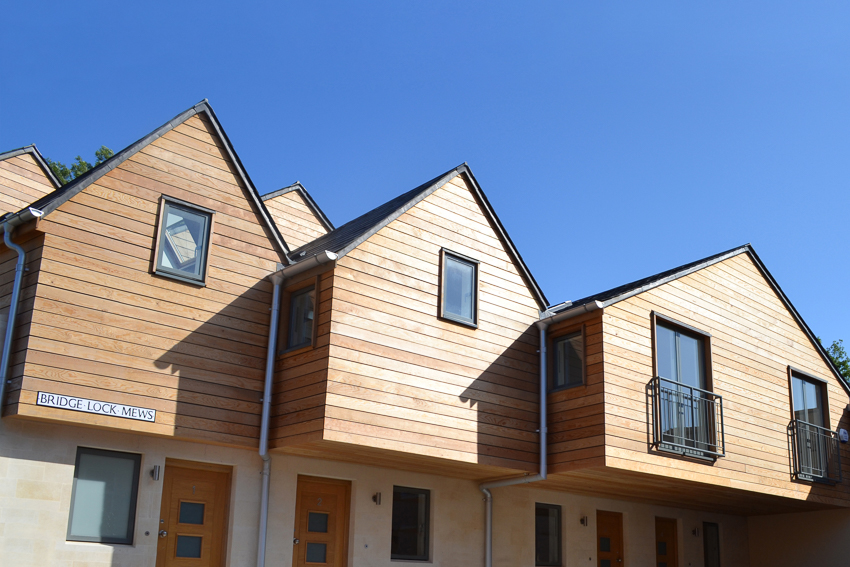 Exterior shot of Bridge Lock Mews showing the entrances and cedar clad second floors