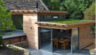 Image illustrating timber clad extension with sedum roof
