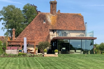 Copper and glass extension to grade 2 listed kent farmhouse