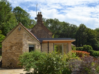 Image showing garden room extension in foreground and original cottage beyond