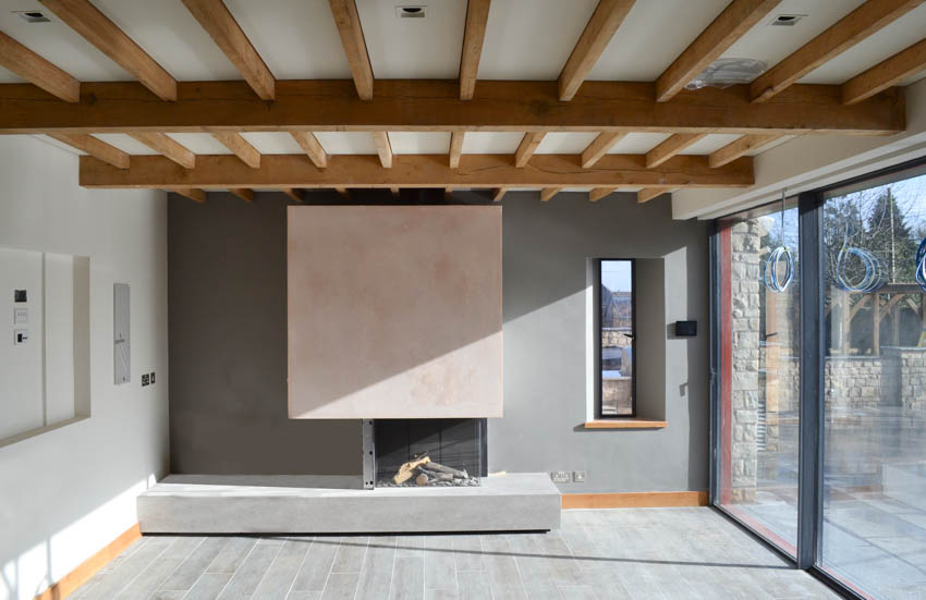 Image illustrating the final stages at the Jacobean House extension construction showing the fireplace and the glazing installed at the listed Manor House Extension