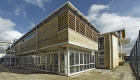 External view of full height glazing and timber cladding and timber louvres to John Cabot Academy 6th form centre