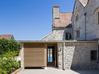Photograph of the new approach to the extended portion of the house, with access through to the garden through large glass sliding doors.