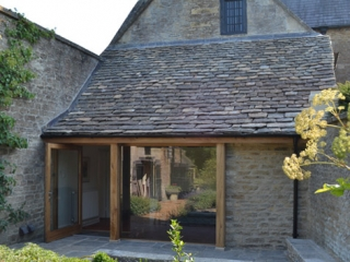 Image showing the oak and glass reworking of the ground floor exterior of this Georgian house, showing how the old blends with the new, opening up the back of the house and linking it to the garden.