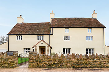 Image of mill house exterior eco friendly refurbishment in a traditional listed building