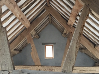 Image showing the original roof beams in the historic 17th Century farm buildings at Jamies Farm.