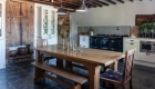 Photograph highlighting the renovation works completed to the main house kitchen with contemporary new kitchen juxtaposed against the existing historic fabric.
