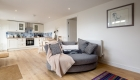 Photograph visualising the open plan kitchen/livign space of one of the ground floor holiday lets