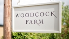 Photograph of the 'Woodcock Farm' road signage.