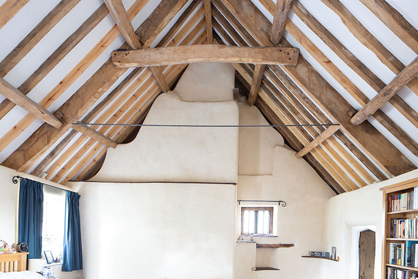 Image of eco refurbishment showing traditional exposed timber structure and render