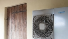 Image of and eco-friendly, sustainable, air source heat pump and traditional wooden door and exposed roof structure