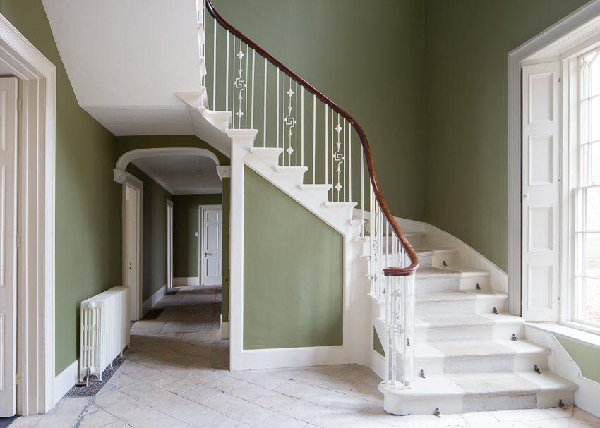 Image of a beautiful staircase and hallway with large window