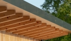 zoomed image of externally exposed timber rafters and eaves