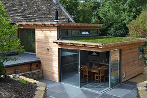 Image of a contemporary extension with horizontal cladding and green roof